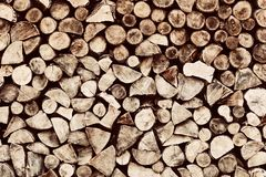 Pile of wood logs background, pattern. Pile of brown wood logs background, pattern. Vintage tone Stock Photos