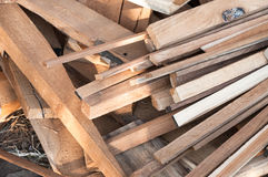 Pile of wood logs for build Furniture production,sew natural wood scraps Royalty Free Stock Image
