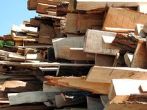 Pile of wood planks. A pile of wood planks out on the yard Stock Image