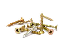 Pile of wood screws. Isolated on white background Stock Photography
