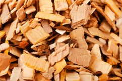 Pile of wood smoking chips. On white background royalty free stock photography