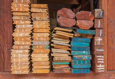 Pile of wood stored in stock on shelf. Royalty Free Stock Photography