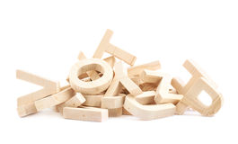 Pile of wooden block letters isolated. Pile of multiple wooden block letters isolated over the white background Stock Image