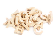 Pile of wooden block letters isolated Stock Photos
