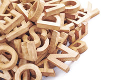 Pile of wooden block letters isolated Royalty Free Stock Photo