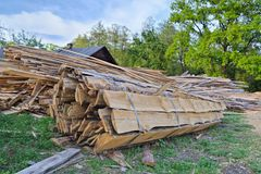 Board sawmill. Pile of wooden boards ready for transportation at the yard of a small sawmill Royalty Free Stock Images