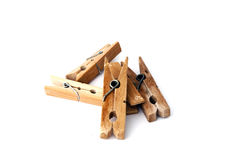 Pile of wooden clothespins isolated on white Stock Photo