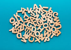 Pile of wooden english letters background. Copy space. Alphabet study, abc, education concept Royalty Free Stock Images
