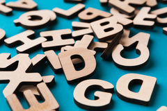 Pile of wooden english letters background. Copy space. Alphabet study, abc, education concept Stock Images
