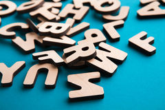 Pile of wooden english letters background. Copy space. Alphabet study, abc, education concept Stock Image