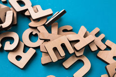 Pile of wooden english letters background. Copy space. Alphabet study, abc, education concept Royalty Free Stock Photo
