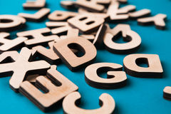 Pile of wooden english letters background. Copy space. Alphabet study, abc, education concept Royalty Free Stock Image