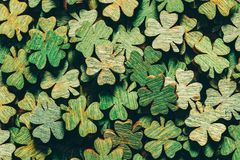 Pile of wooden green four-leaf clovers. Laying down. Luck symbol. St. Patrick`s day Stock Images