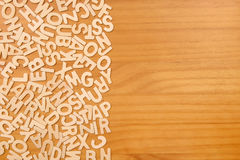 Pile of wooden letters over the wooden surface. As a typography background composition Stock Photography