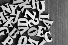 Pile of wooden letters over the wooden surface as a typography background composition. Abc Royalty Free Stock Photos