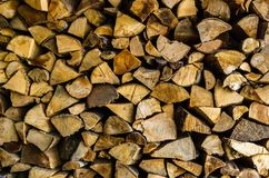 Pile of wooden logs stacked up with some good textures and colors for backgrounds royalty free stock photos