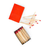 Pile of Wooden matches with box isolated over the white background Royalty Free Stock Image