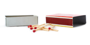 Pile of Wooden matches with box isolated over the white background Stock Image