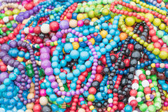 The pile of wooden necklaces closeup Stock Photography