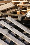 Pile of wooden pallets piled in a landfill Royalty Free Stock Photo