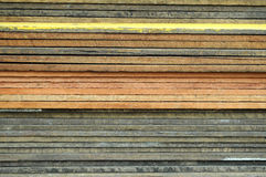 Pile of wooden plank. A pile of wooden planks in different colors Royalty Free Stock Image
