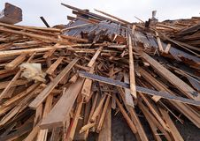 Pile of wooden planks at demolition site ready the recycling Stock Image