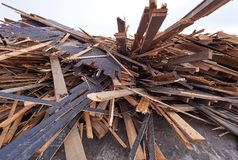 Pile of wooden planks at demolition site ready the recycling Stock Photos