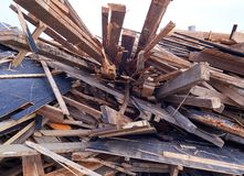 Pile of wooden planks at demolition site ready the recycling Royalty Free Stock Image