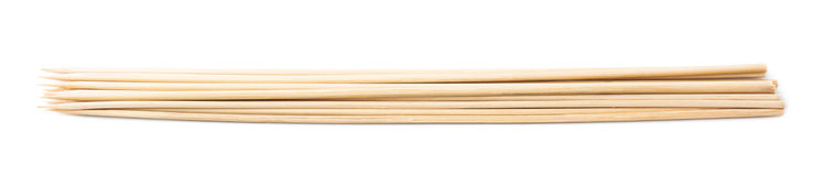 Pile of wooden skewers isolated Royalty Free Stock Photography