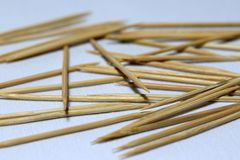 Pile of wooden toothpick put on the white floor. it is a short pointed piece of wood used for removing bits of food. royalty free stock photography