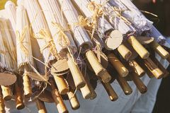 A pile of wooden umbrella for wedding souvenir with empty name tag, close-up stock photography