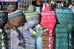 Pile of woolen caps Stock Photos