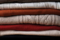 Pile of woolen sweaters stacked on top of each other Royalty Free Stock Image