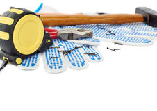 Pile of working tools over isolated white background Royalty Free Stock Photos