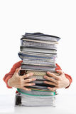 Pile of workload. Male hands holding pile of paperwork, over white background Stock Photography