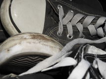 Pile of worn out sneakers. Pile of old used canvas and leather sneakers Royalty Free Stock Photo