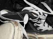 Pile of worn out sneakers. Pile of old used canvas and leather sneakers Stock Photo