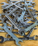 Pile of Wrenches. A pile of wrenches  on a wooden background Royalty Free Stock Photos