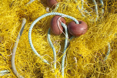 Pile of yellow fishing net Royalty Free Stock Image