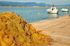 Pile of yellow fishing nets in port Royalty Free Stock Photography