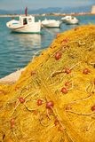 Pile of yellow fishing nets in port Royalty Free Stock Photos