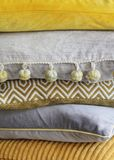 Pile of yellow and grey cushions Royalty Free Stock Image