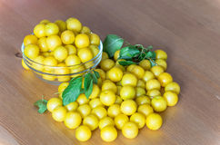 Pile of yellow mirabelle plums on wooden table Royalty Free Stock Images