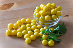 Pile of yellow mirabelle plums on wooden table Stock Photography