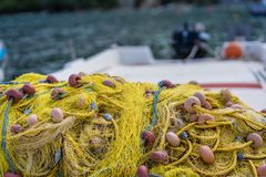 Yellow nets on a boat deck. Pile of yellow nets on a fisherman boat deck in Zante Island, Greece royalty free stock photo
