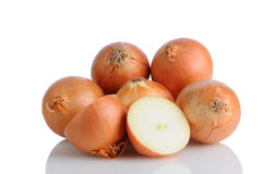 Pile of Yellow Onions on White Royalty Free Stock Image