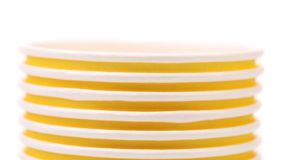 Pile of yellow paper coffee cup. Close up. Stock Image