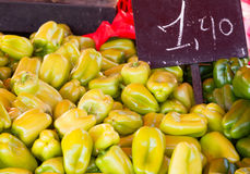 Pile of yellow peppers farmers market offer Stock Photography