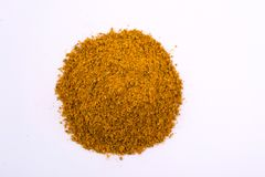 A pile of a yellow spice mix for kari . Isolated on white background. Spices consist coriander turmeric ginger pepper black red cinnamon bay leaf royalty free stock photography