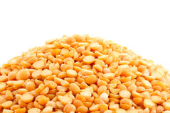 Pile of yellow split peas on white Stock Image
